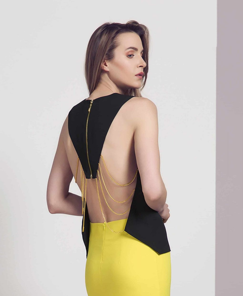 Alila Boutique black and gold chain open back top by Explosion.