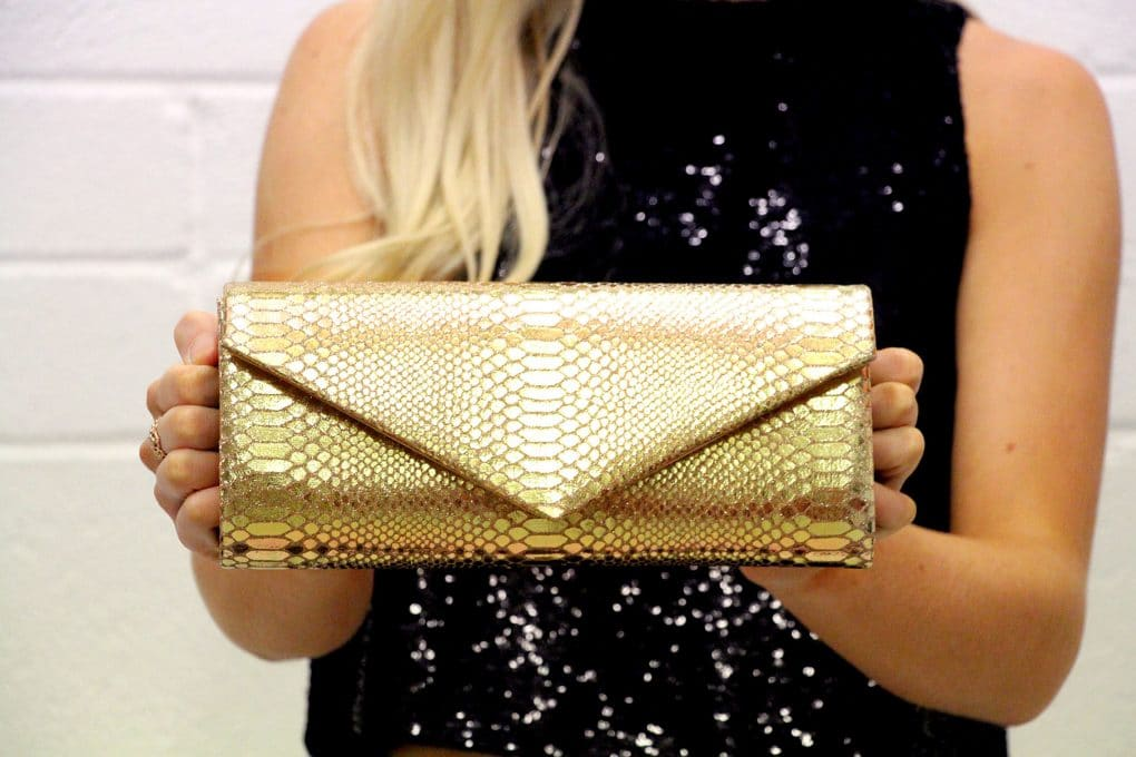Alila-Gold-Python-Clutch-Bag-Mascara-Close-Up